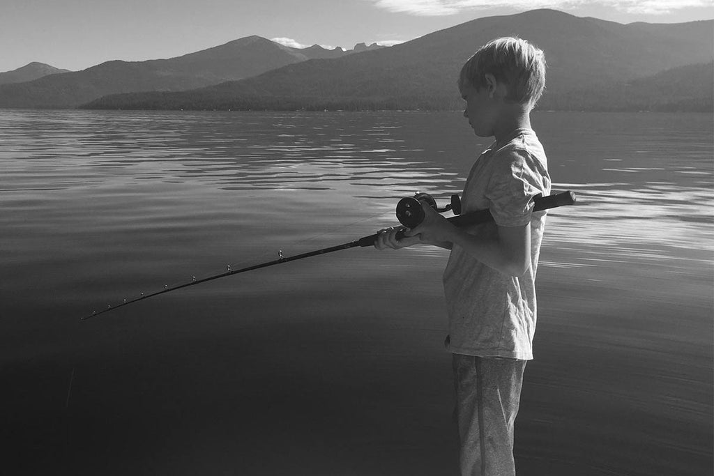 boy fishing for trout