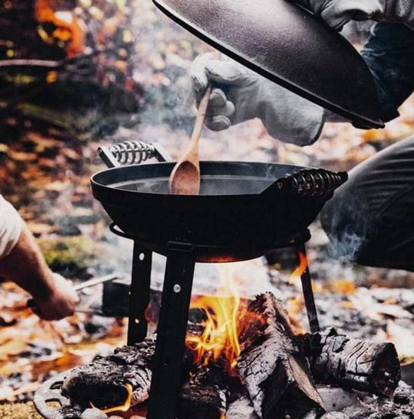 man cooking with an all in one grill
