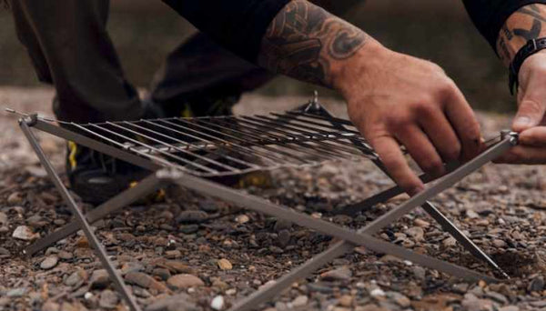 man setting up M1 grill