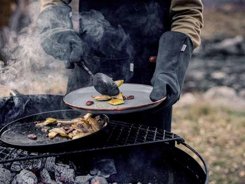 cooking over a campfire with open fire gloves
