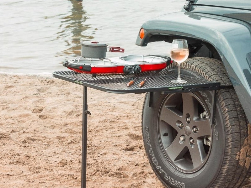 tailgater table attached to a jeep on a beach