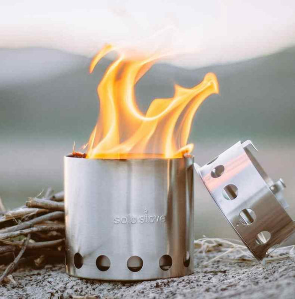 burning twigs in a solo stove lite