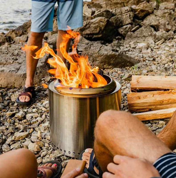 solo stove ranger burning on a beach