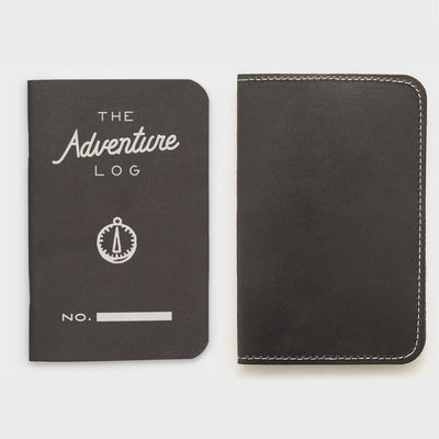 black adventure log with leather sleeve