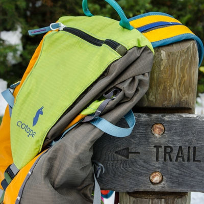 tarak backpack on trail sign