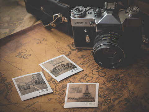 image of map and vintage film analogue camera with film