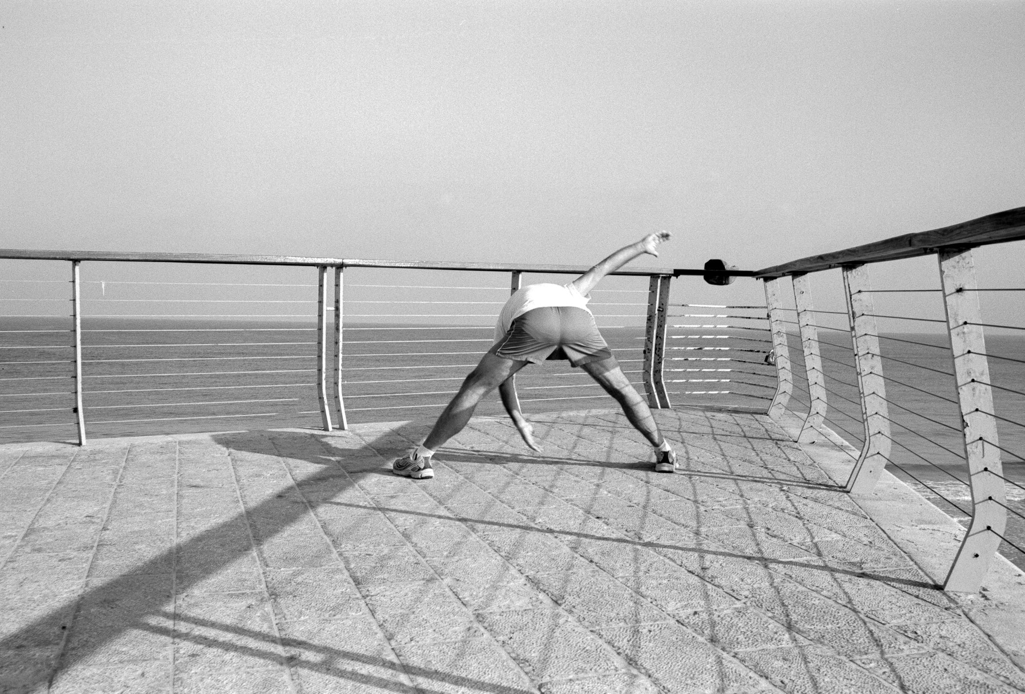 Photo taken on Fuji Acros B&W 35mm film - man doing stretches