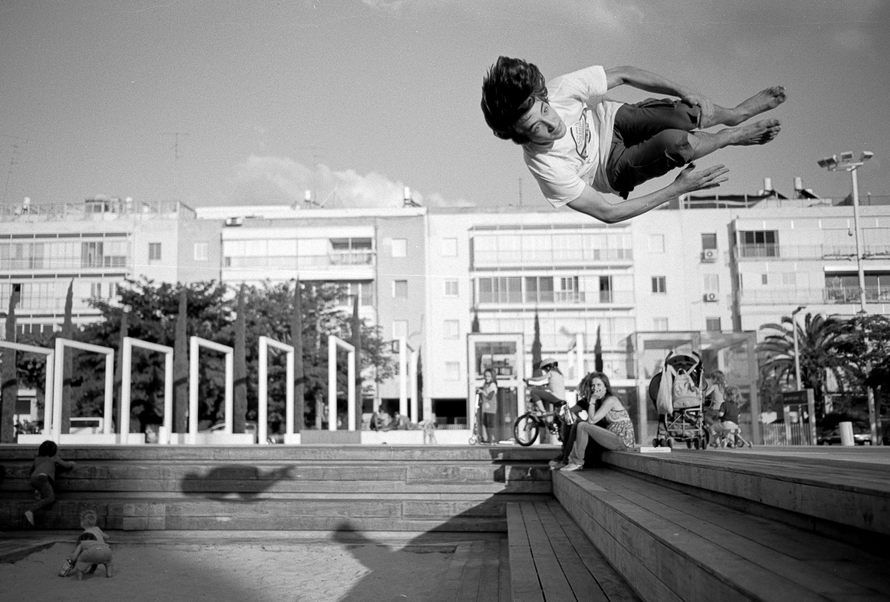 Photo taken on Fuji Acros B&W 35mm film - man doing acrobatics
