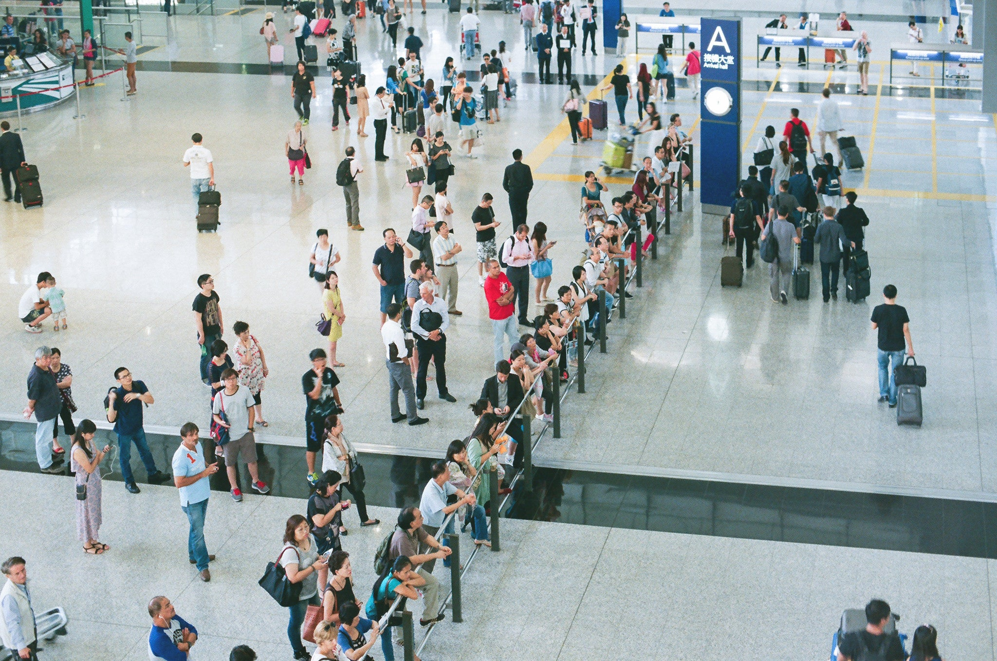 Photo of airport arrivals shot on agfaphoto vista iso 200 35mm colour film