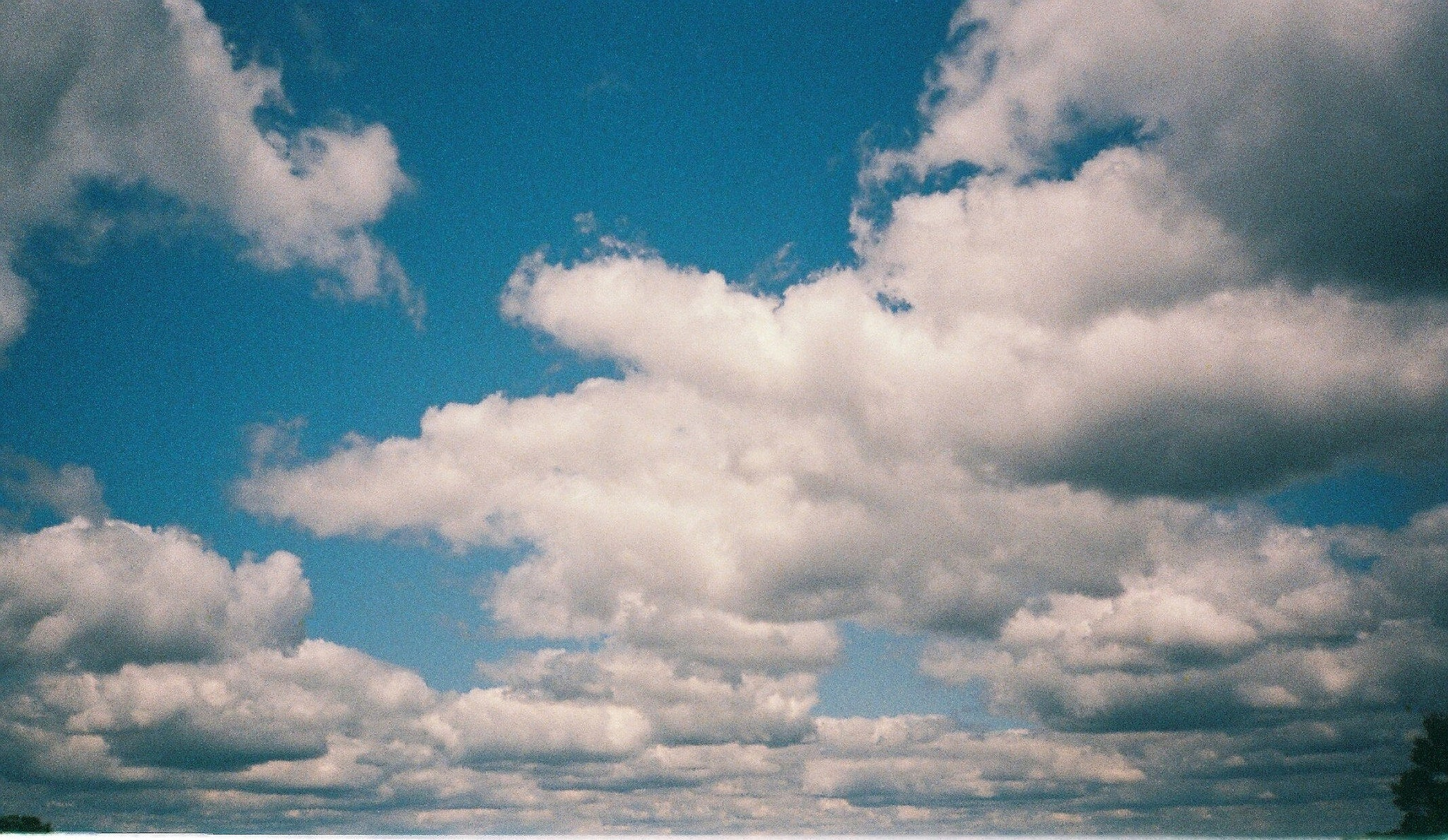 Photo of clouds and sky taken on expired Konica APS colour film