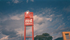 Photo of red sign taken on expired Konica APS colour film