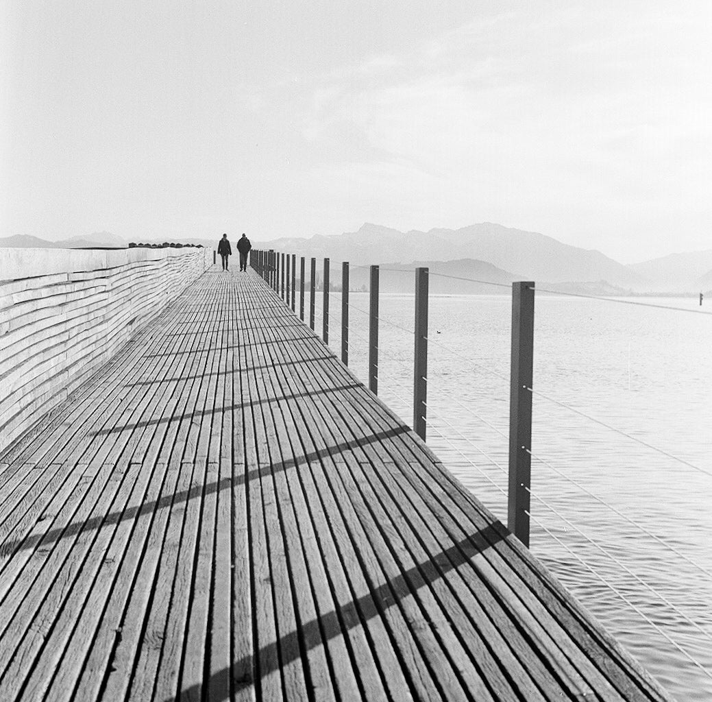 Sample film photo of pier into sea on ilford hp5 plus B&W medium format film - 120