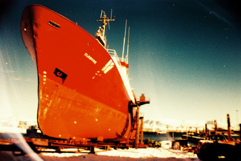 sample shot of boat taken on lomography camera with 35mm film