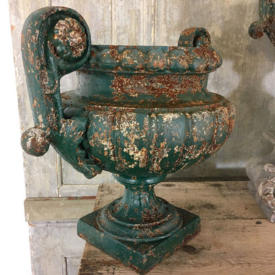PAIR OF 19TH CENTURY CAST IRON PEDESTAL URNS SOLD
