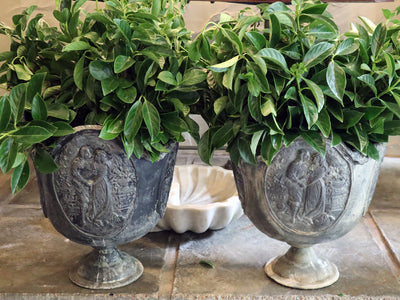 A Pair of Victorian cast lead wedding urns