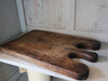 A 19th century oak bread board