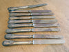 A set of 9 French 19th Century Silver butter knives by maker Orfevrerie