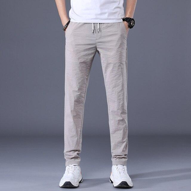 QUANBO 2020 summer new men's ice silk casual pants men's slim straight thin section Fashion Trousers male small feet  pants - EM