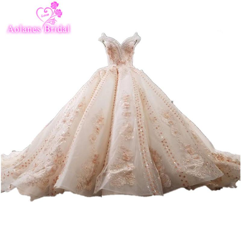 New Luxurious Lace Appliques Beaded Crystals V Neck Puffy Wedding Gown Champange Wedding Dress Wave Skirt 3D Flower Bridal Dress