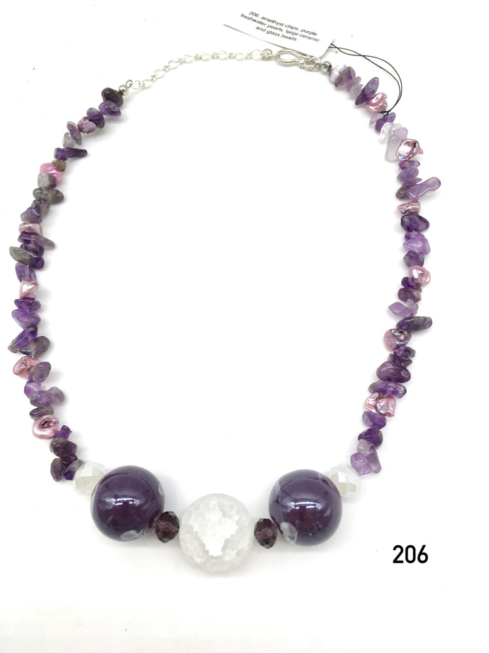 Amethyst chips, purple freshwater pearls, large ceramic and glass beads created by Dorothea Drew Designs of NJ