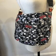 Cross-body Messenger Bag, fully reversible with a total of 12 pockets and adjustable strap.  Pop-culture, Star Wars, Star Trek, Walking Dead, Wonder Woman, Vintage Steampunk and flowered patterns.