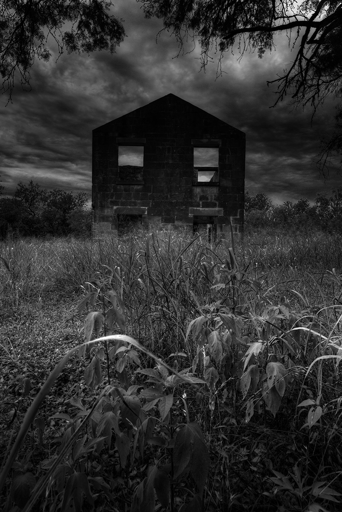 Homestead - dark black and white photograph of an abandoned rural house
