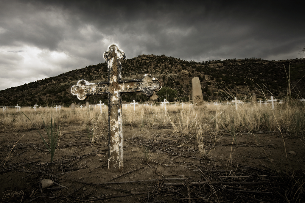 A abandoned miner's grave, from a New Mexico ghost town landscape