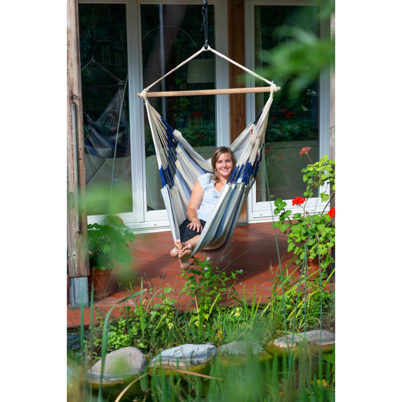 Hammock Chair Hung in Garden from Overhead Beam