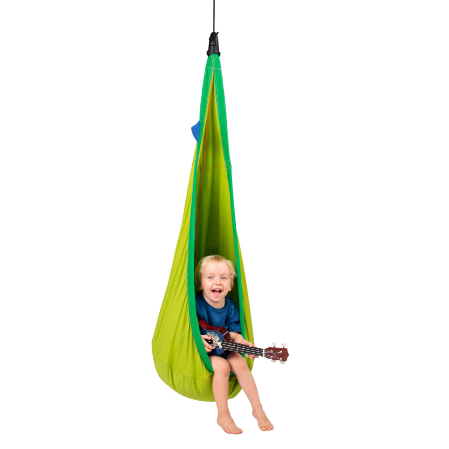 Child playing in hanging nest hammock