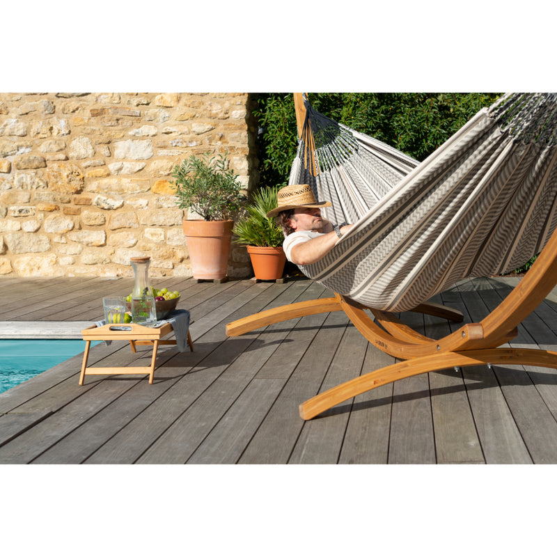 Wooden hammock stand on deck