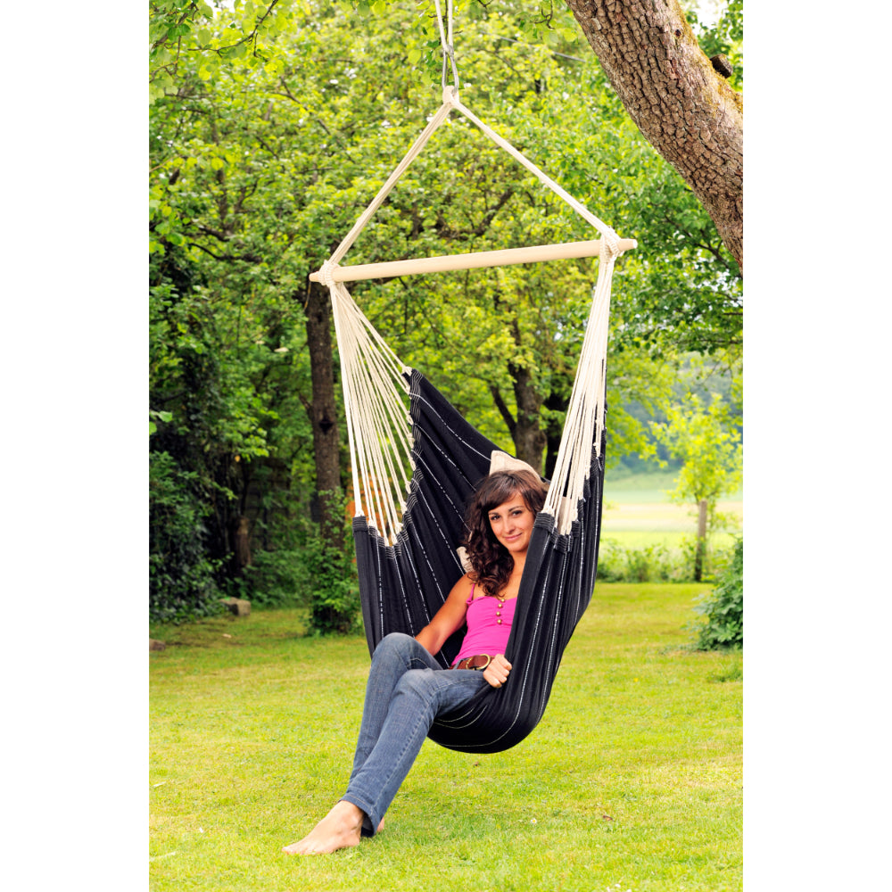 Hammock garden chair hanging from branch