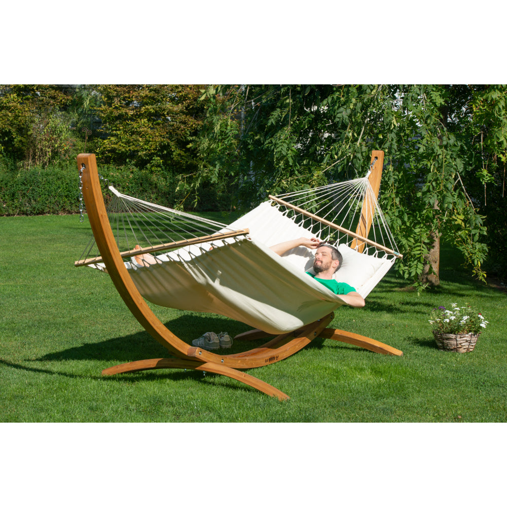 Wooden arc hammock stand and off-white organic cotton bar hammock