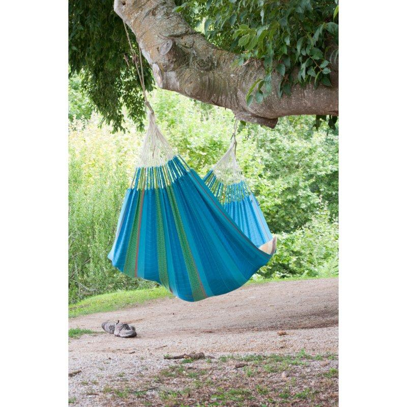 Cotton hammock hung from tree