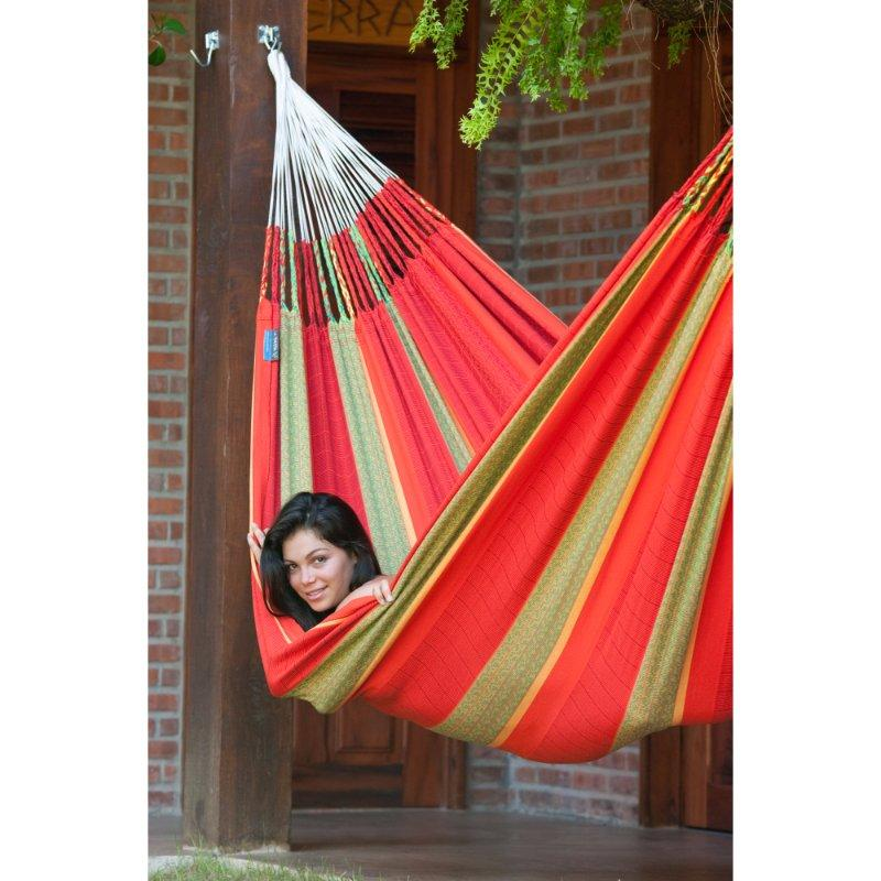 Red cotton hammock on post