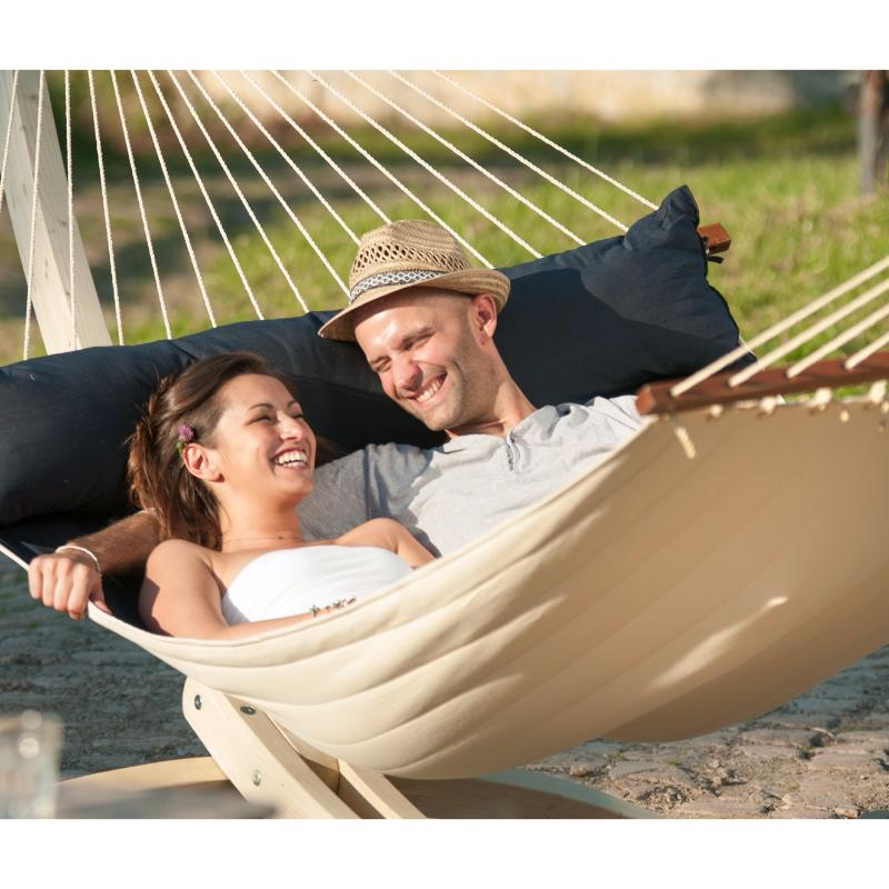 Couple in king size spreader bar hammock