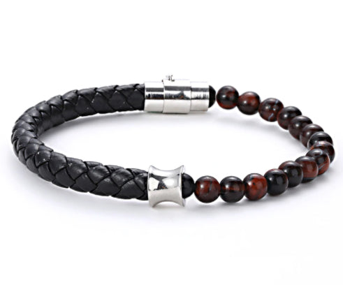 Made of natural 8mm tiger's eye, meticulously braided and tied together with our signature finishing touches to our Stainless Steel Titanium clasps. This powerful yet elegant piece is the perfect accessory for any occasion, whether dressed up or casual.  Stainless Steel Titanium clasps & connectors Natural 8mm Tiger's Eye Length: 18.5cm 20.5cm 22cm
