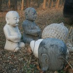 Stone buddhas in the grounds of the Beijing antique workshop