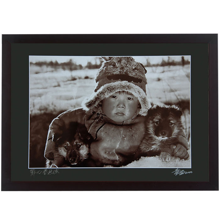 Framed Print - 'Young Oroqen Boy with Puppies'
