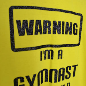 warning im a gymnast_glitter shirt from star performance co closeup
