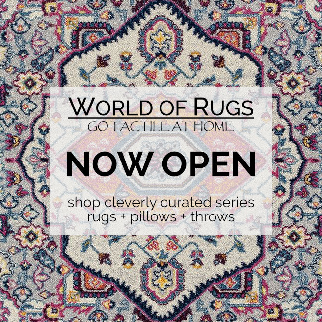 Bohemian styled area rug design used as background for WORLD OF RUGS  Blog title page. Announcement for new online website to shop curated trio of products: coordinated area rugs, sofa pillows and cozy throws.