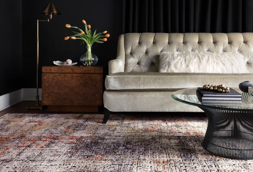 Velvet Couch, Black Walls, Brass Lighting, and a Fun Rug? Looks like the best way to combine our favorite decorating trends for 2019.