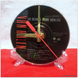 "CD Clock made w/a VAN HALEN Compact Disc / ""For Unlawful Carnal Knowledge"" Stand Included"
