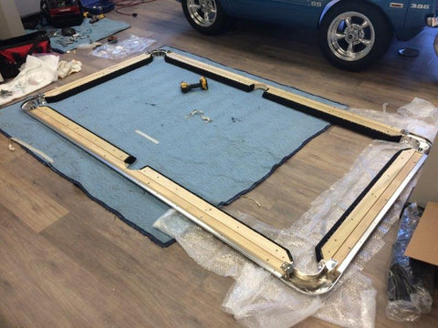 Quality components on display during the setup of a car pool table in our showroom