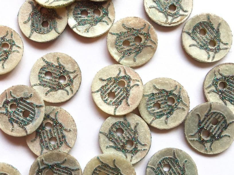 14mm - Shell with Blue/Green Glitter Beetle TextileGarden Buttons & Fasteners