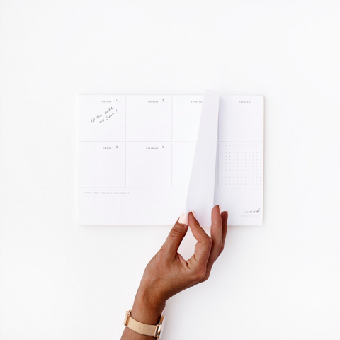 ladies hand turning pages of a calendar