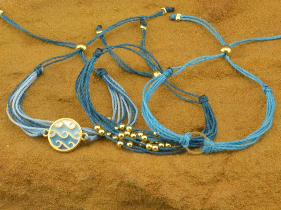 gold wave string bracelet stack