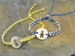 string bracelet with boy girl charm