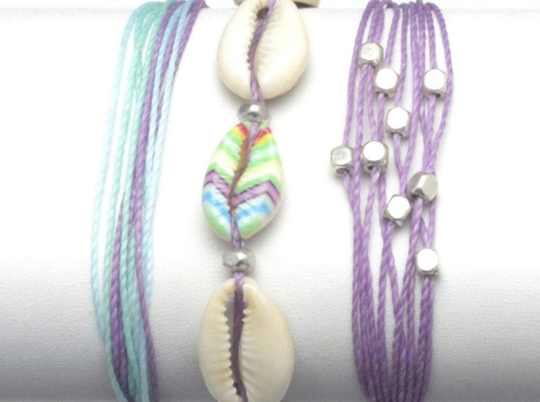 beach stack bracelets with painted cowrie shell