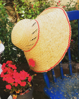 Straw sun hat with red edging