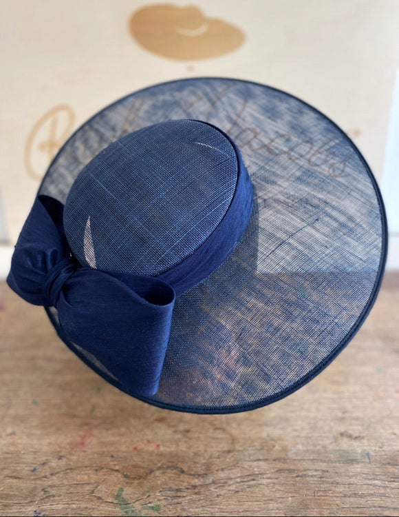 Navy blue mid size brim wedding hat with navy blue silk band with navy blue silk bow. Rivka Jacobs - millinery